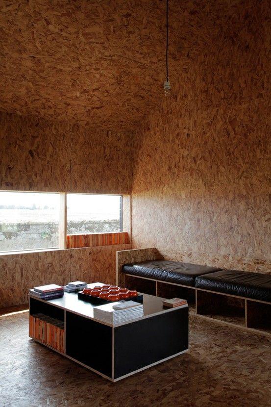 extended ochre barn media room OSB walls furniture and flooring:
