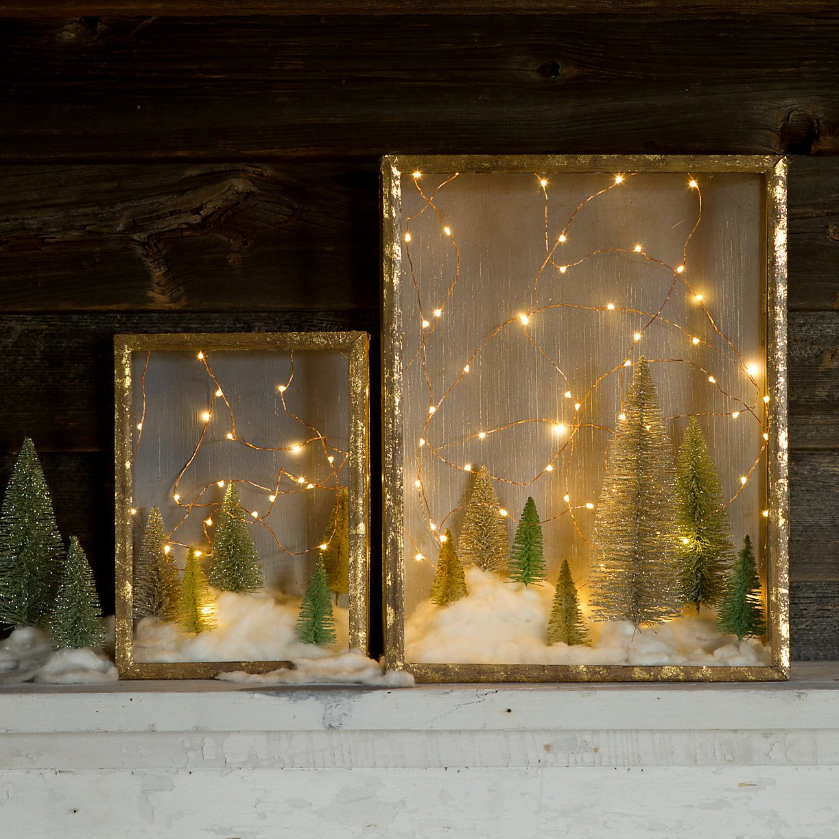 Draw attention to tabletop holiday decor by draping it with lights.