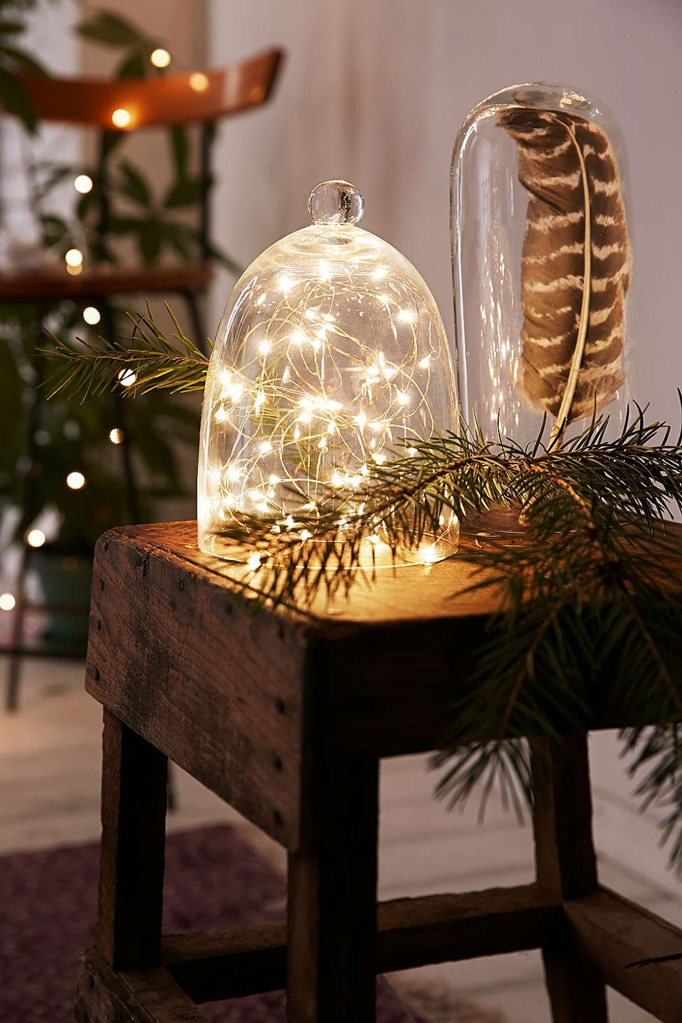 Fill a terrarium with glimmering bulbs for a magical effect.