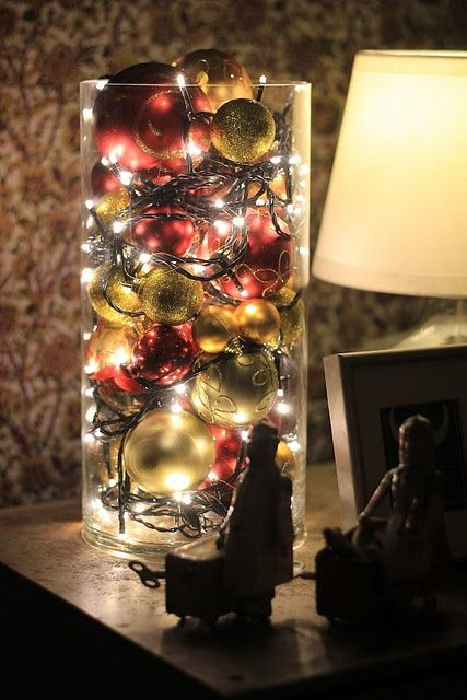 Hallway lighting: old ornaments and twinkly lights in a glass jar: