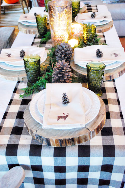 Lindsay from the White Buffalo Styling Co. brought the outdoors in with this centerpiece of fresh greenery, large pinecones, and mercury glass. Her favorite part of the tablescape? The cream napkins with hand-painted deer. Get the tutorial at The White Buffalo Styling Co.