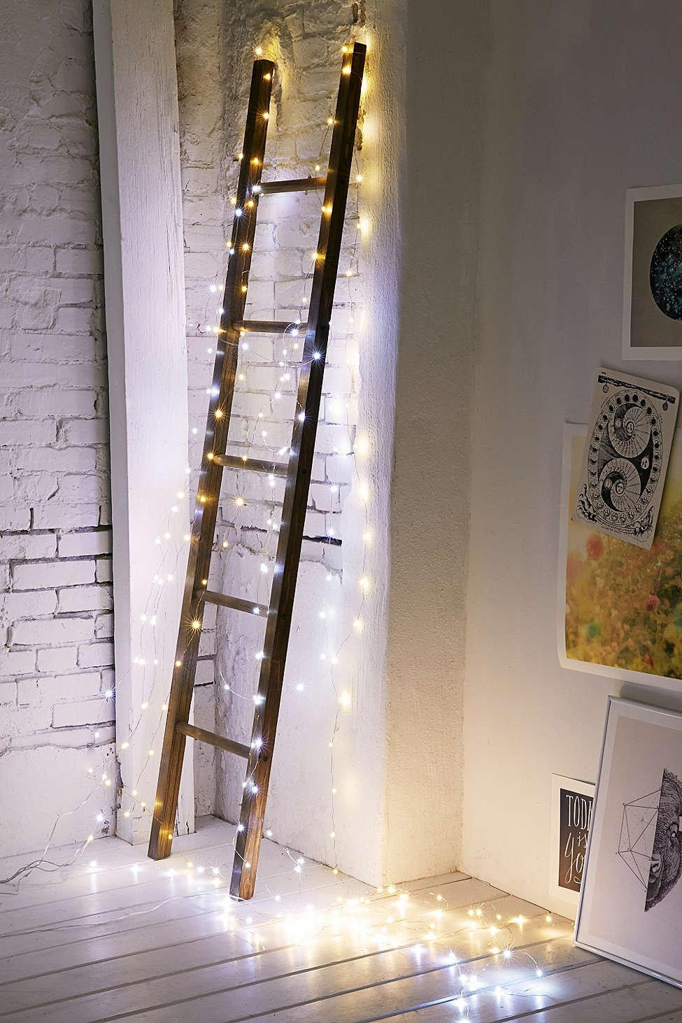 Make a decorative ladder Christmas-ready by encasing it in lights.