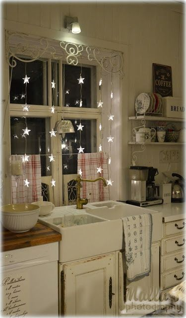 Star lights in the kitchen window: