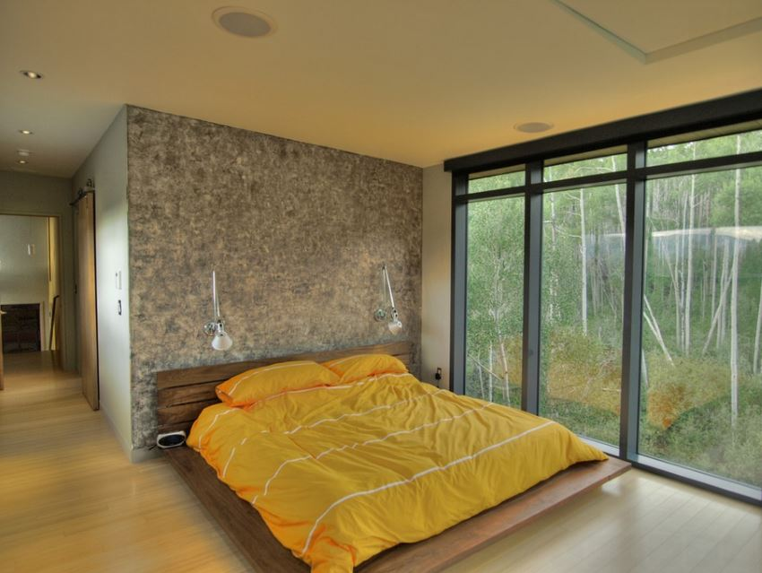 Contemporary bedroom with a forest view