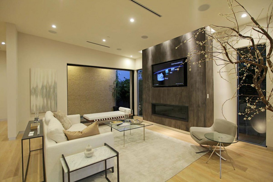 Indoor blossoms in a modern living room 10 Rooms With Elegant Indoor Plants