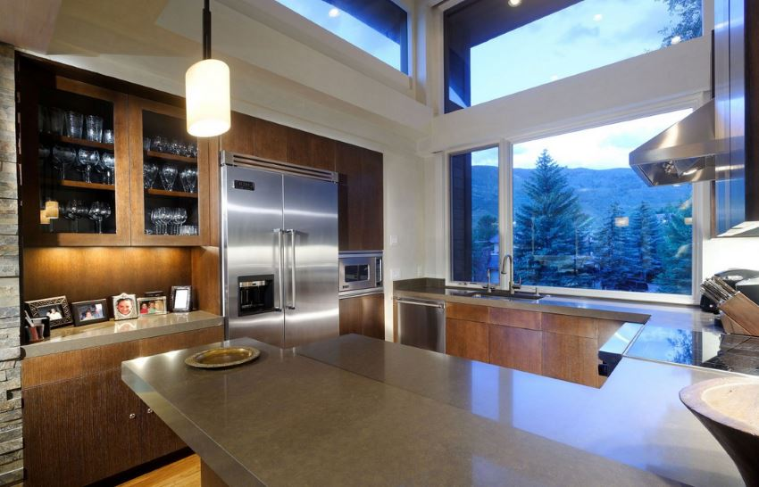 Kitchen with a forest and mountain view