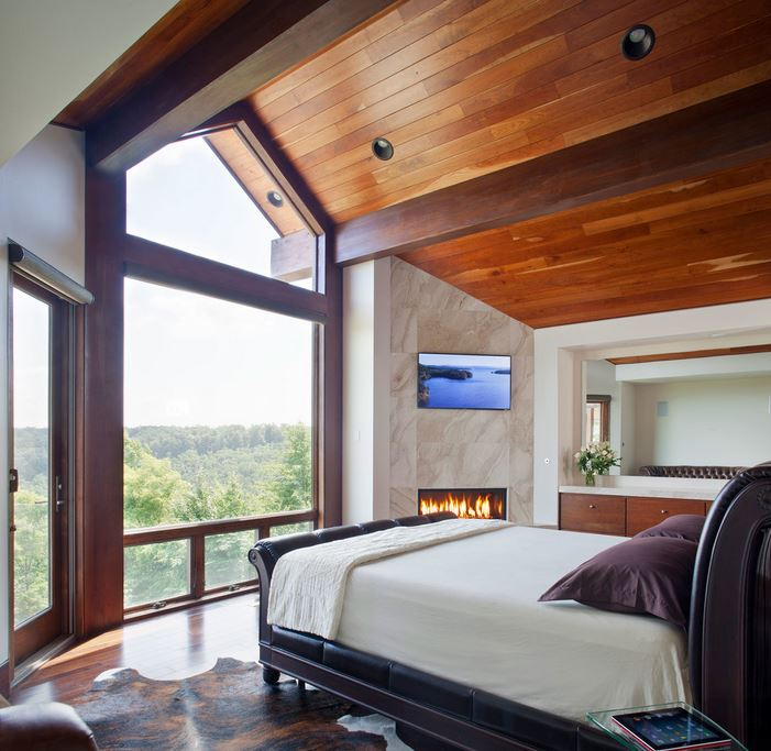 Modern bedroom with a stunning forest view