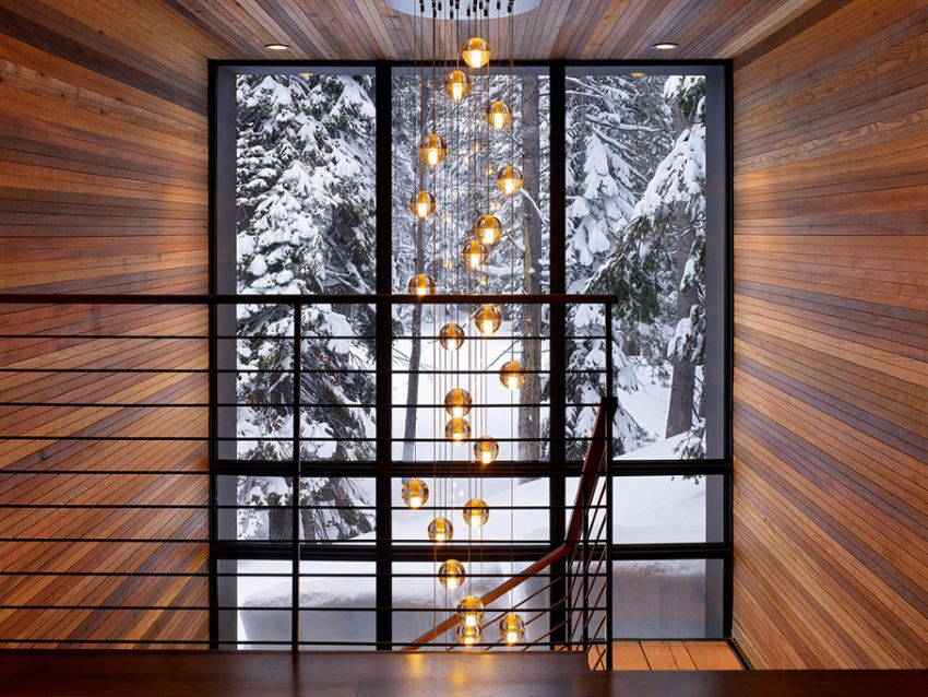 Modern staircase with a snowy wooded view