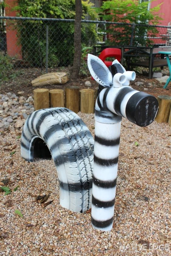 What a Zebra! This Zebra was created with an old tire and PVC. After scrubbing the tire clean to use as the main body, we managed to use one last recycled piece of PCV for the neck and head!:
