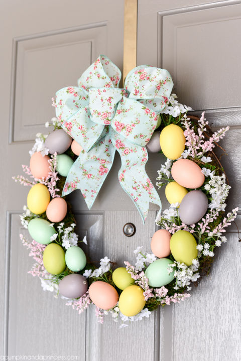 Dress up a basic grapevine wreath withpastel eggs, moss and flowers to add a bit of spring to your front door. Get the tutorial at A Pumpkin & A Princess »