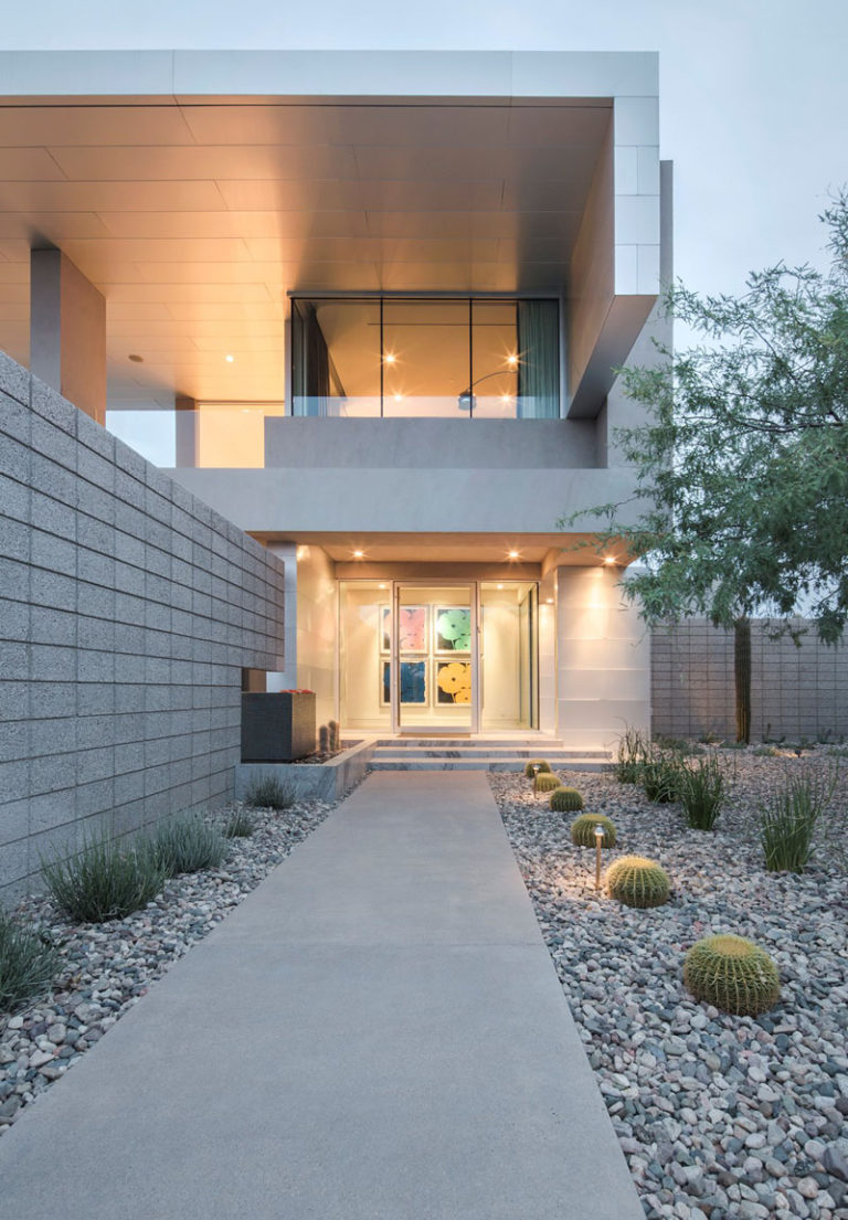 11 Inspirational Rock Gardens To Get You Planning Your Garden // The entrance way and backyard of this home uses rocks and cacti to bring plant life in and watering responsibilities out.
