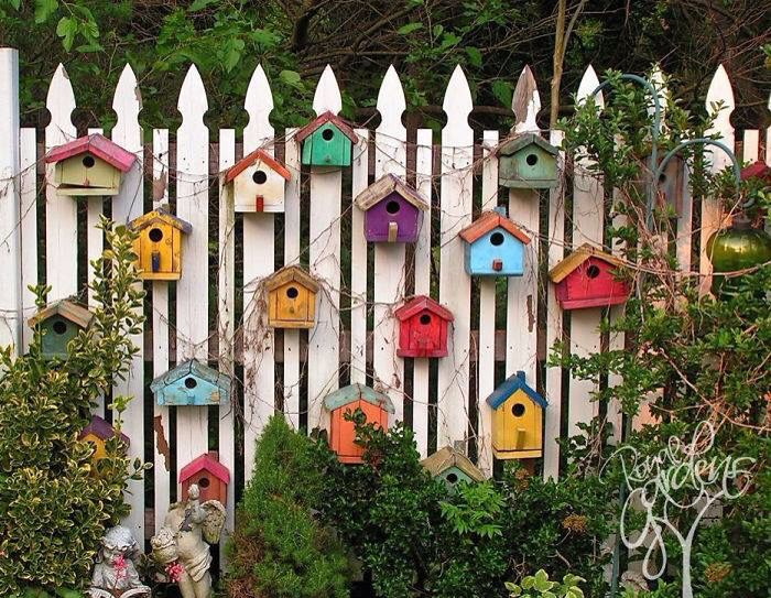 Image result for colourful bird houses fence