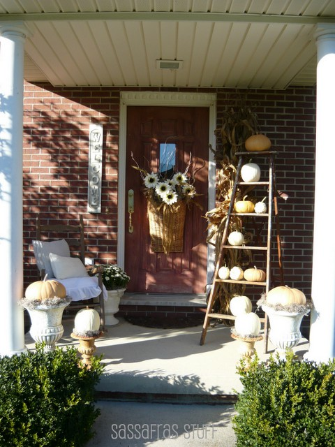 A vintage ladder would become a perfect display for front porch decor.