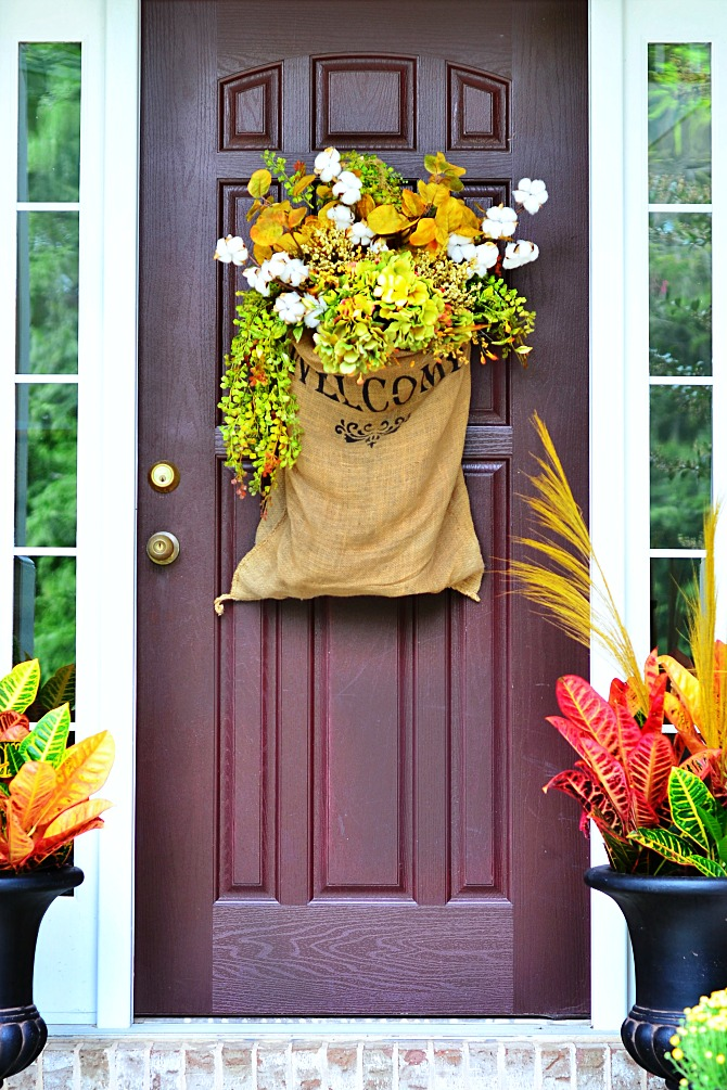 Faux plants are even better for decorating a front porch than real ones. There is no need to water them.
