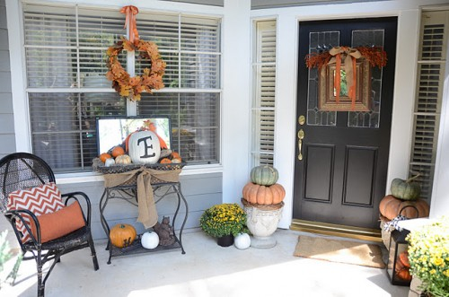 In order to create an interesting Fall display just add a small side table to your porch. Pumpkins are the first thing that comes to our mind when we're deciding what to display on this table.