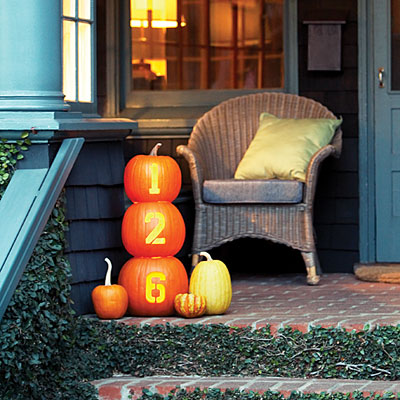 Making a glowing house number of pumpkins is one of those ideas that could be used for halloween decor too.