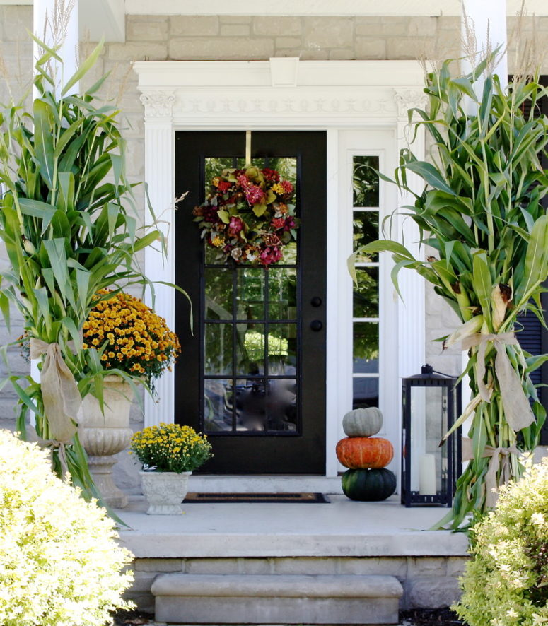 Oversized mums, pumpkins, lanterns and cornstalks would be a great addition to a fall wreath.