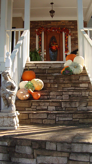 Placing pumpkins on your front steps is a great way to create the mood right away.