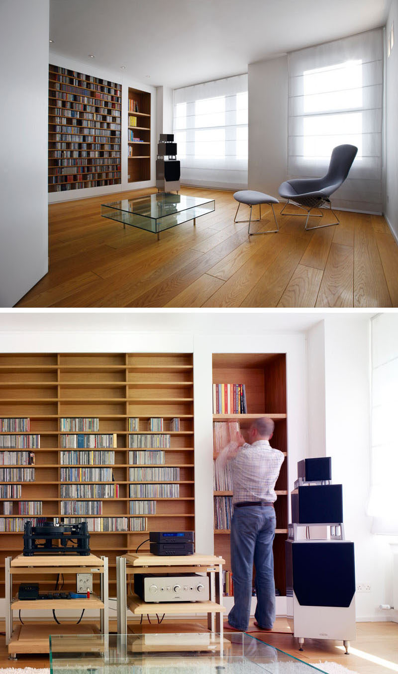Custom shelves have been built into the wall in this music room and are lined with wood to make them stand out. #shelving #BuiltInShelving #WoodLinedShelving #WoodLinedBookshelf