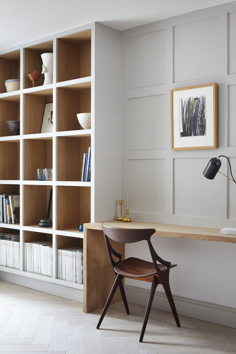 Each wood box in this built-in shelving unit has the front painted the same color as the wall to allow the wood to act as an accent. #shelving #BuiltInShelving #WoodLinedShelving #WoodLinedBookshelf