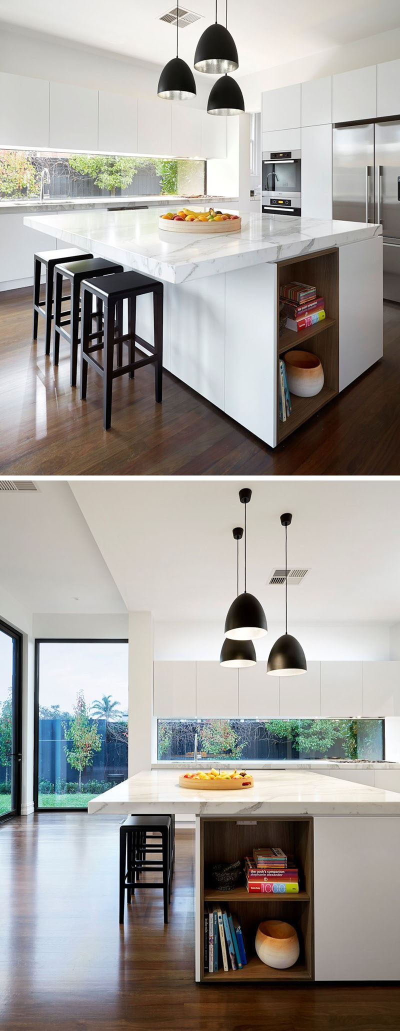 This white kitchen has wood built-in shelving in the kitchen island that's ideal for storing cookbooks. #WhiteKitchen #BuiltInShelves #WoodLinedShelves #KitchenIsland