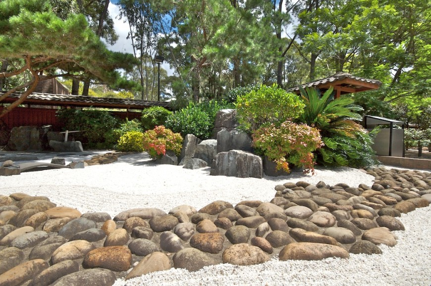 Here is a zen garden outlined by a large rock ring. It separates the garden from the rest of the space but keeps with the organic motif of the garden.