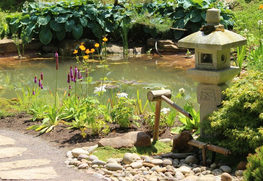 Stone lanterns and bamboo features are commonly associated with Japanese gardens. Adding features like this is a way to instantly introduce Japanese influence into your space.