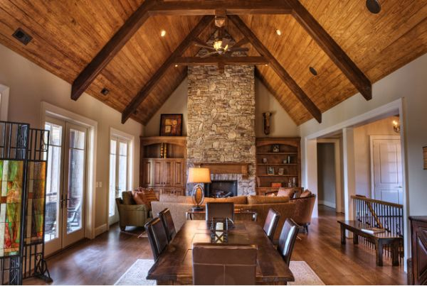 https://cdn.homedit.com/wp-content/uploads/2014/01/high-ceiling-living-room-stone-fireplace-wooden-beams.jpg
