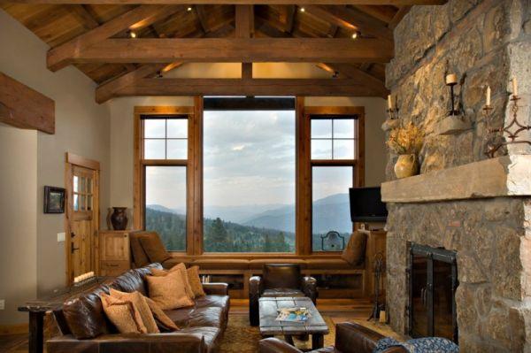 https://cdn.homedit.com/wp-content/uploads/2014/01/stone-fireplace-living-room-views.jpg