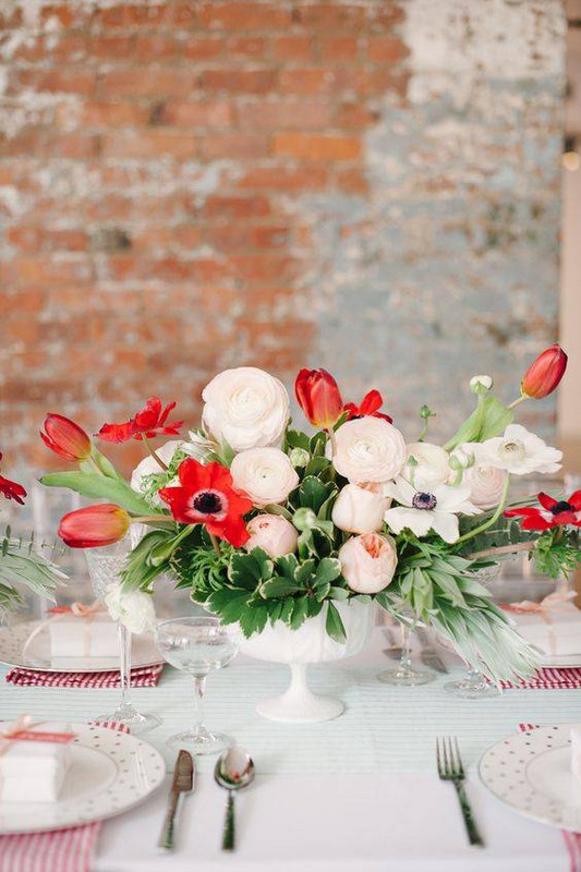 Spring Flower Arrangements white and red flowers on a table